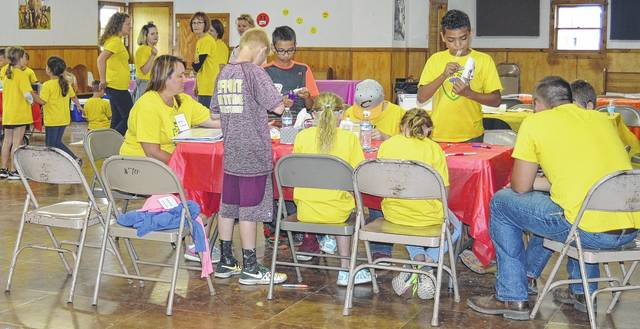 Campers work on their crafts.