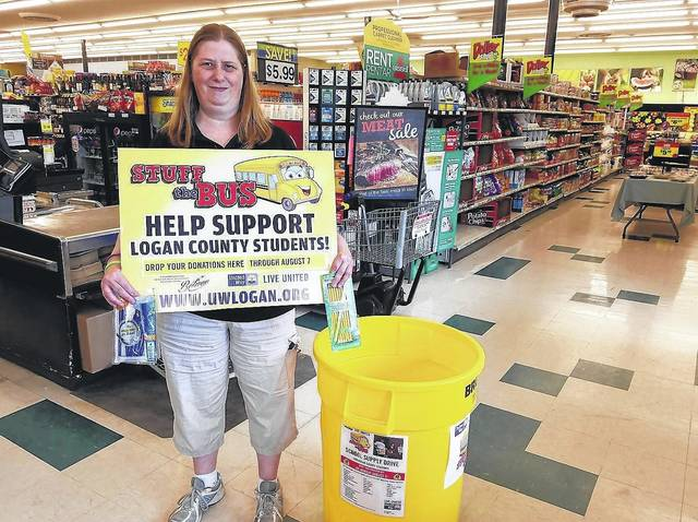 Tammy Keller, manager of the Community Markets store on North Main Street in Bellefontaine, sets up the store's Stuff the Bus collection bin. Community Markets is one of 28 local workplaces and retail locations collecting school supplies for United Way of Logan County. The Stuff the Bus drive runs through Monday, Aug. 7.