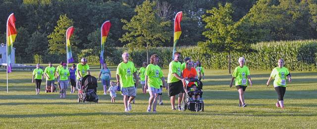 Residents of all ages participate in the annual Young Life Memorial Run/Walk, with some simply along for the ride.