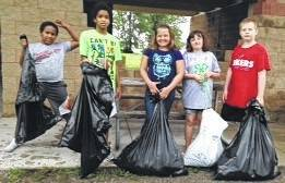 Community service is a big part of 4-H in Logan County. The Lucky Lakers 4-H group showed what that meant by cleaning up the beach area at Old Field Beach one rainy Saturday morning. Discarded flip flops, cans, diapers, fast food wrappers and shorts were picked up and placed in five large bags of trash. Members pictured are Christopher Kretzmann, Landon Kretzmann. Carly Baldwin, Addisyn Butler and Stevie Spofford.