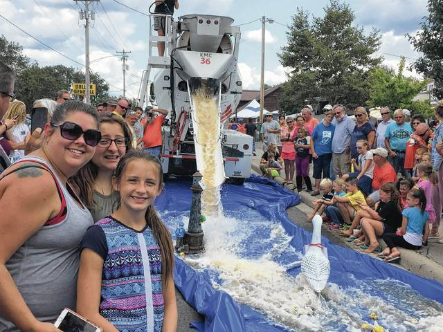 It was a fun day at HarborFest as Miranda Fox and daughters Bella and Sophie watch thousands of yellow rubber duckies slide down the chute at the Indian Lake Duck Slide event.