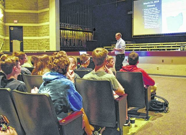 Logan County Board of Elections Director Adam Brannon meets with students at Indian Lake High School.
