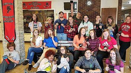 Indian Lake High School Art Club members hold their Harry Potter-inspired notepads.