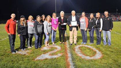 From left are Indian Lake Interim Superintendent Rob Underwood, Indian Lake Athletic Boosters members Michelle Parsell, Heather Shepherd, Tara Snyder, Jess Miller, Robin Jenkins, Lori Zarnosky, Brenda Reichert, Dr. Steven Grothaus, Brandi Altstaetter, Carrie Cummins, Jill Wurster and high school Principal Kyle Wagner.