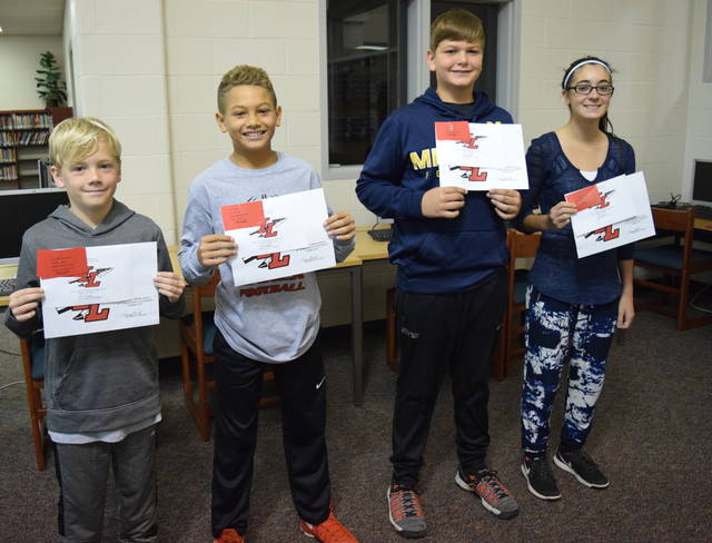 Indian Lake Middle School students, from left, Reece Shepherd, Caiden Nicol, Kaleb Schindewolf and Erika McWilliams are the school's October Students of the Month, meaning they are among those who started the year off right when it comes to academics, attendance and attitude. They are selected by their teachers for demonstrating good citizenship, achieving good grades and generally setting an example for other students. They receive a certificate, a homework pass, a pass to the front of the lunch line for a month, a free Cassano's pizza and an ice cream treat.