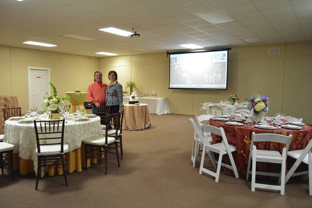 The owners of Markin's Farms, 550 E. township Road 30, West Liberty, stand in the Event Center with tables decorated to show different price ranges offered for weddings and receptions. If looking for a place to hold a wedding, reception and honeymoon, check out the property's Country Wedding Barn, Event Center and Tiny House. The facility offers a wedding consultant, event planner, sound booth, large media center, wireless microphone WiFi, dj services, catering, photographs, cake designing and optional dance floor setup. The 196-square-foot Tiny House has a loft, full kitchen and bath, gas heat, air conditioning and large screen TV. And, try out the 13 ziplines and 6-foot-high rope challenge course at Markin's Farms Zipline Adventures. For more information call 937-465-0358 or e-mail markinfarmes@gmail.com. The website is www.markinfarms.com.