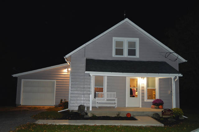 The Country Cottage Guest House opened near West Liberty.