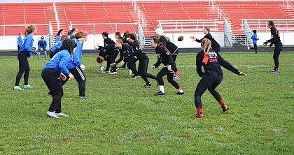 Sophomore team quarterback Hailey Westberry takes a snap during the Class of 2020 victory over the Freshman. The Sophomores went on to defeat the Senior girls in the Championship game.