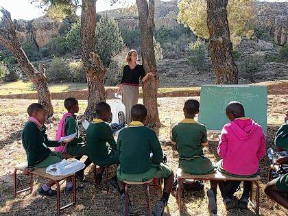 West Liberty-Salem grad Hillary Seely teaches students of a Christian school outdoors in Lesotho, Africa.