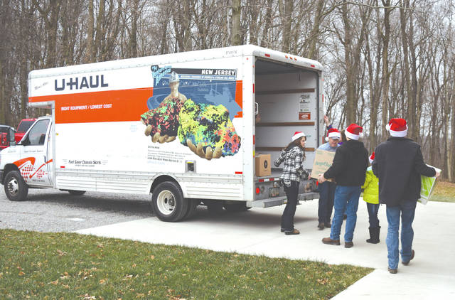 Volunteers unload about 3,000 toys from a U-Haul truck. The toys were donated to children at the Nationwide Children's Hospital.