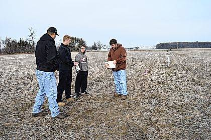 Indian Lake FFA/OHP students are investigating what nutrients the school farm needs for maximum yields in the future. They recently spent time soil sampling and testing the entire acreage for the first time in at least 15 years. They pulled samples from points laid out from a GPS grid to look at the minerals and nutrients currently in the soil. IL FFA Instructor Tanner Schoen explains this will provide a blueprint on what and how much fertilizer to spread over the next 4 years. Agronomy and Precision Ag teams from Sunrise Cooperative assisted in the testing and talked with students about other aspects of modern agriculture technology. When the test results are complete, the Sunrise team will return to the classroom and analyze the results with the students to develop a nutrient plan and explain why such a plan is needed.