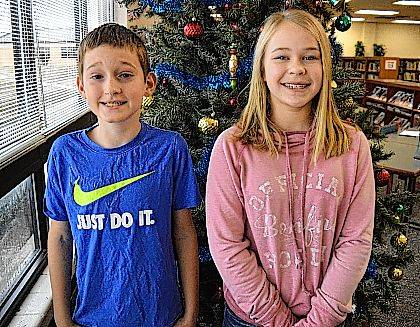 Indian Lake Middle School students Isaiah Kirby and Regan Ross spelled their way to advance to the Logan County Spelling Bee.