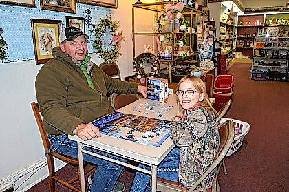Patrick Neer and his daughter Rachael take a brief break from their puzzle to have a photo taken at MCC Thrift.