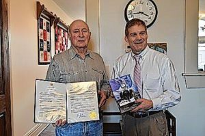 Jordan presents proclamation to local author