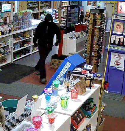 This surveillance footage shows a would-be robber at Lester's Tobacco Shack in Russells Point on Wednesday.