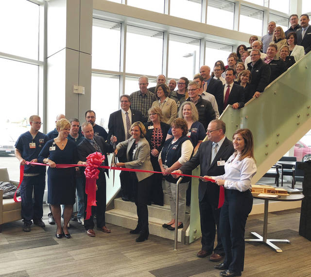 Local leaders cut the ribbon at the new Mary Rutan Health Center in Bellefontaine on Feb. 22.