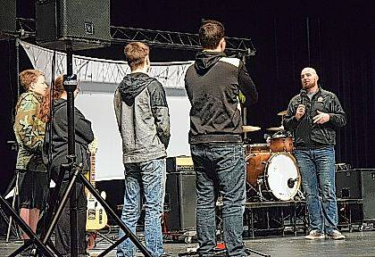 Former OSU football player Joel Penton talks with students on stage March 20.