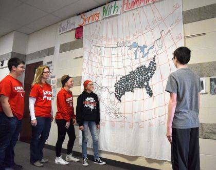 Mrs. Core and several ILMS 7th graders check out the hummingbird migration map.