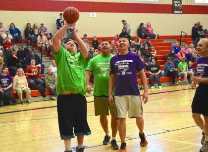 Special Olympian Joe VanVoorhis sinks a bunny shot during the Community Outreach Basketball game.