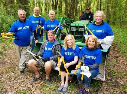 Teams from Choice Properties Real Estate and Vectren helped clear walking trails at Indian Lake State Park.