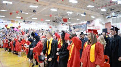 Indian Lake seniors-turned-graduates gleefully toss hats into the air at the close of the May 20 graduation ceremony.
