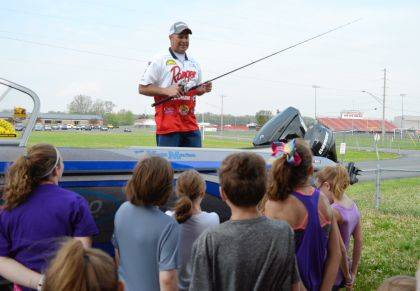 Professional fisherman Mike Defibaugh of Logan County speaks to students at Indian Lake Elementary School.