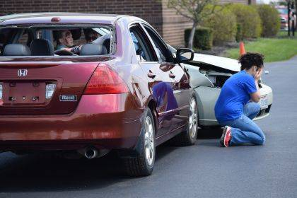 Indian Lake High School SADD member MaryAnn Wahl collapses in tears near the mock crash when she realizes her impaired driving killed her passenger.