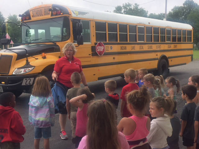 Indian Lake Bus Driver Nancy Beatty talks bus safety with Russells Point Safety Town students, while driver Lori Carpenter operates the signs and lights on the bus.