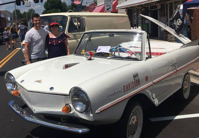 Orchard Island couple Larry and Pat DePasquale are organizing the 50th Anniversary Celebration of the iconic amphibious vehicles which will be held in Celina, Ohio in late July. Pictured is Pat DePasquale and son, Larry Jr. at the 2018 Lakeview Car Show.