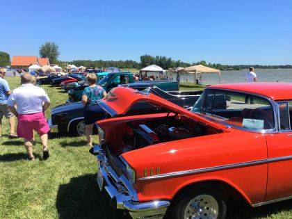Vehicles and vehicle lovers crowded the beach at Indian Lake during the annual Beach Spectacular.