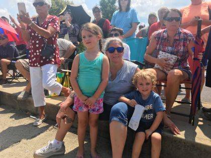 """Hats off to Mayor Robin Reames, who found time to wear the """"hat"""" of Grandma at HarborFest and watch the wacky boat races with grandkids Cora, and Judah, 4."""