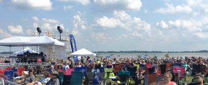 Join the Party at the Beach on Saturday. The fun includes bands, food, drink, a lake, sand and lots of people.