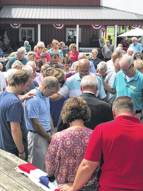 U.S. Rep. Jim Jordan (R-Urbana) bows his head with others during a prayer at a recent Top Of Ohio Patriots event at the Winner Harvest Barn. About 200 guests invited by the TOOP board gathered to hear Jordan, seeking another term in office, as well as to enjoy entertainment and lunch.